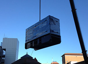 A generator being crained onto a building top and installed for a local council by Enhanced Power Services Ltd