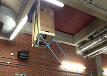 UPS (uninterruptible power supply) being hoisted up and through a small opening during installation by Enhanced Power Services Ltd.